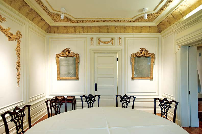 Intricate plaster moldings and appliqués were returned to the dining room.