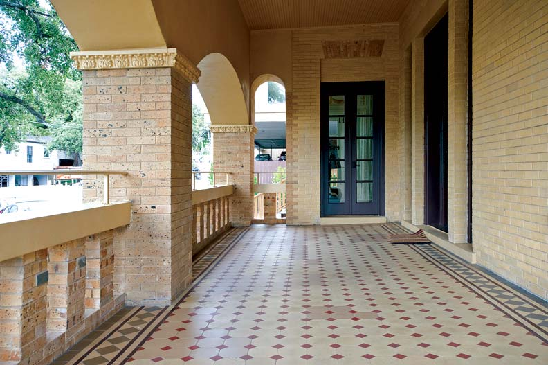 "Victorian geometric tiles on the front porch were unearthed beneath 4"" of concrete—they remained virtually unscathed."