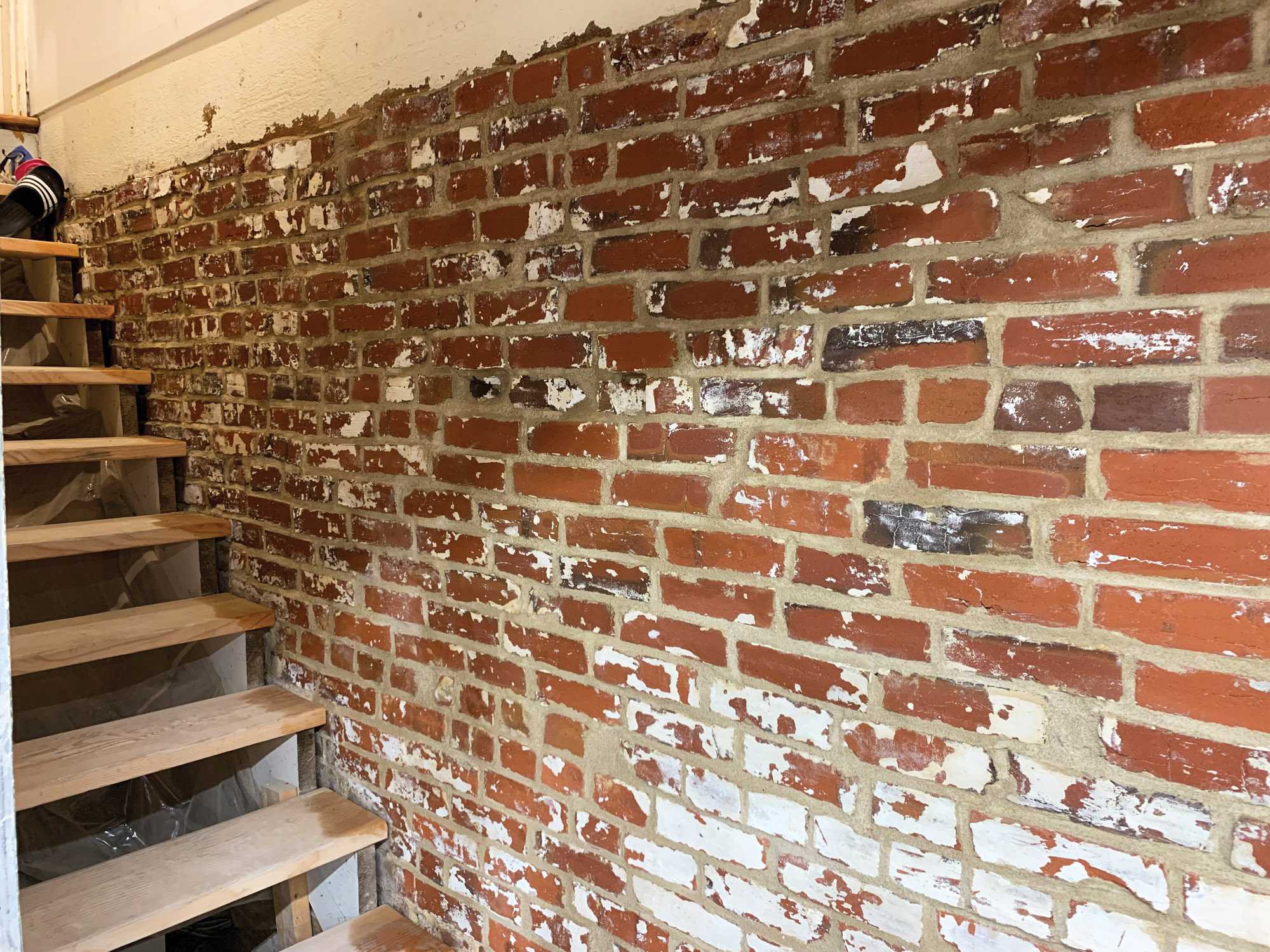 The pattern may be a bit irregular, but the brick in the author's basement is securely repointed, clearing the way for a new project: building a long-anticipated woodworking shop.