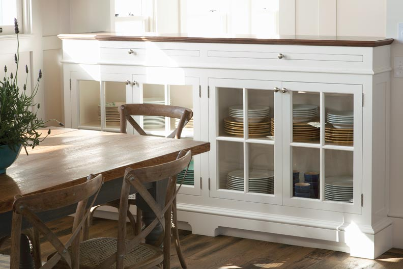 Cabinets are faced with glass doors.