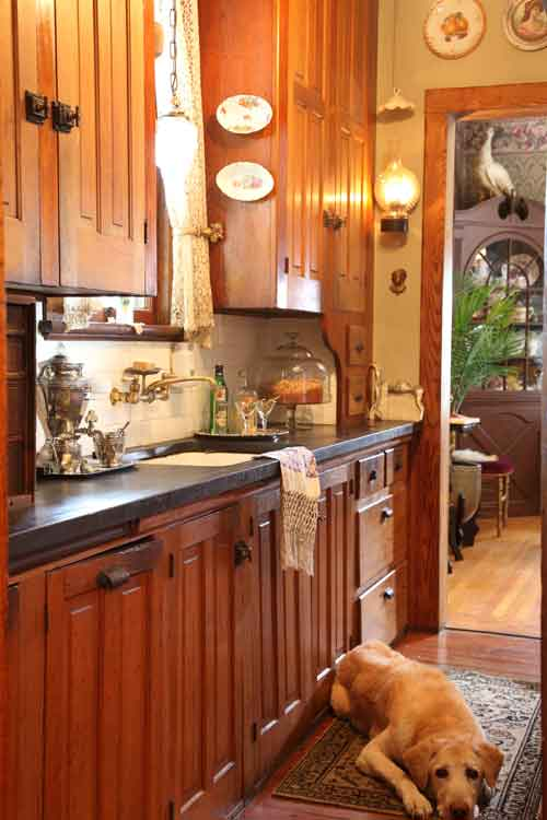 Cabinets in the butler's pantry are filled according to the journals of the original owner: stemware on the right, china on the left