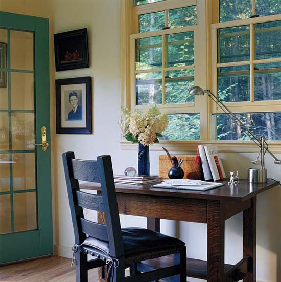 Cardi's writing desk sits before the windows.