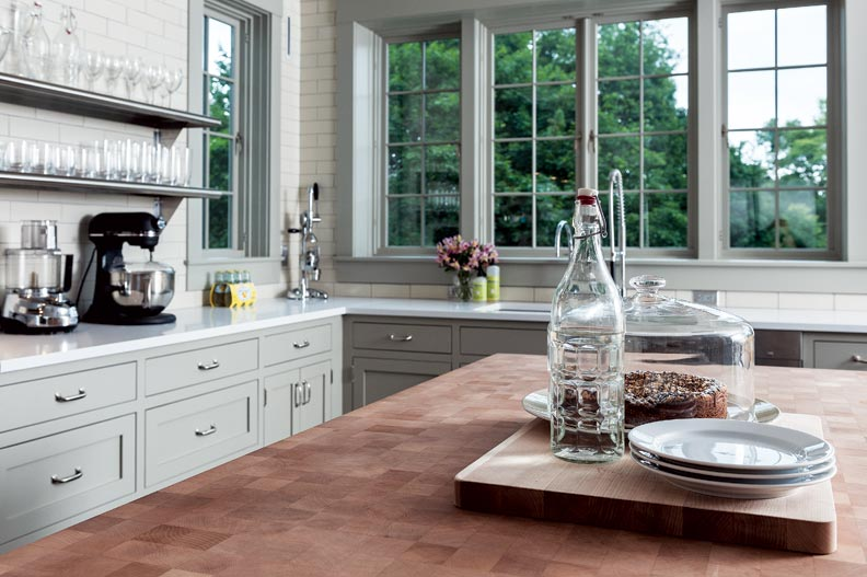 Casement windows over the sink offer a view of the yard as well as cool breezes throughout the day.