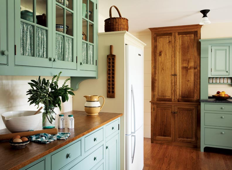 A casual country kitchen old house restoration products for Butternut kitchen cabinets