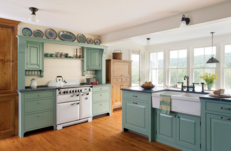 An AGA stove offers a vintage feel to the space. Vitzthum based the design of the cabinets surrounding the stove on colonial hearths.