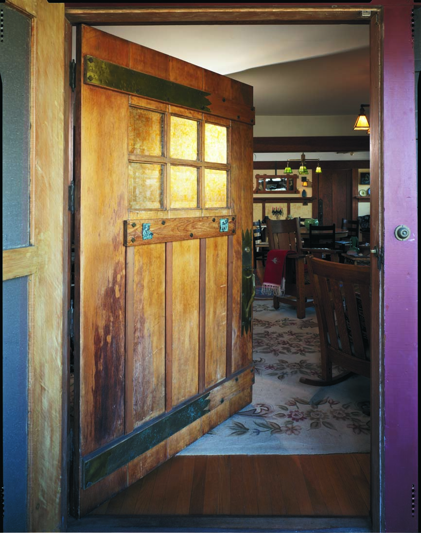 Custom-designed Arts & Crafts doors took on a medieval look with metal hinges and exaggerated fasteners.