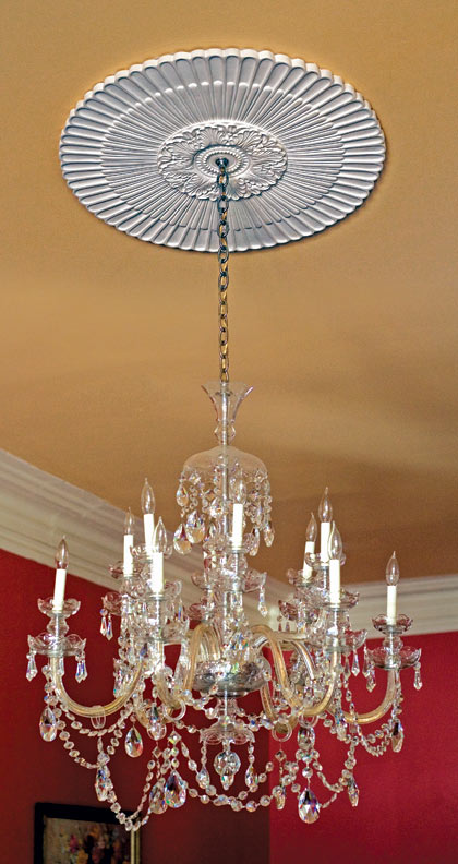 A formal medallion in Washington, D.C.'s Swann House draws eyes to the ceiling.