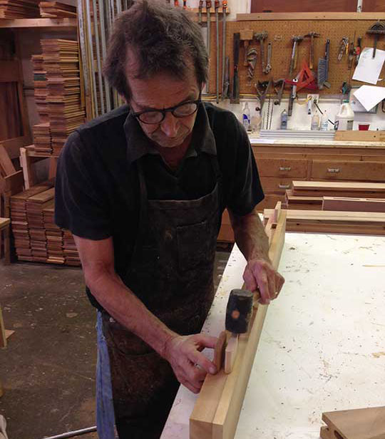 Charles Prowell tapping the tenon into place.