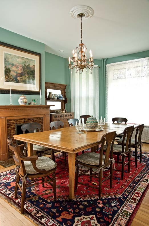 The dining room houses an Eastlake sideboard, which became the inspiration for the new kitchen cabinets.