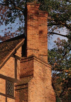 Many old-house chimneys serve a hearth on each floor with multiple flues that snake through offsets within the masonry. (Photo: Paul Rocheleau)