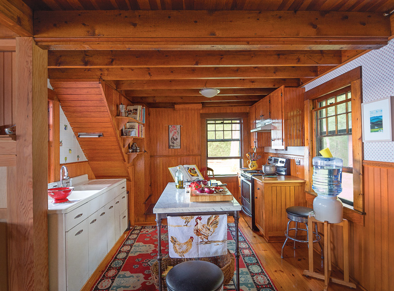 Christine Salembier gets a lot of pleasure from the cabin's original kitchen.