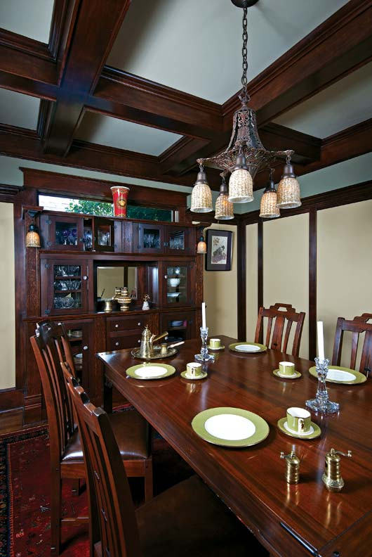 C.J. designed the dining-room buffet to house Nick and Dina's wedding china. The couple had originally envisioned hanging sconces on the wall, but once C.J. realized that would trap the light, he advocated hanging box-beam pendants from the buffet instead.