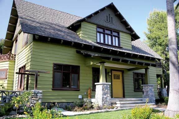 Claremont's historic district has several large bungalows with porch piers made of local stones, like this one. The diamond-paned window and door sash is a distinctive Arts & Crafts feature, while the small lemon tree at left hints at Claremont's citrus-grove past.