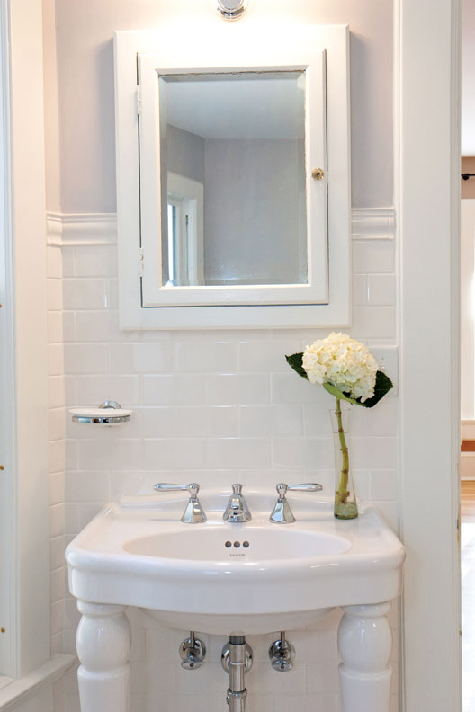 Classic bathrooms get grounded by a few key details, like this statement-making console sink.
