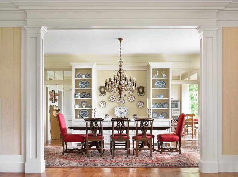 Classical pilasters frame the dining room and establish a sense of formality.