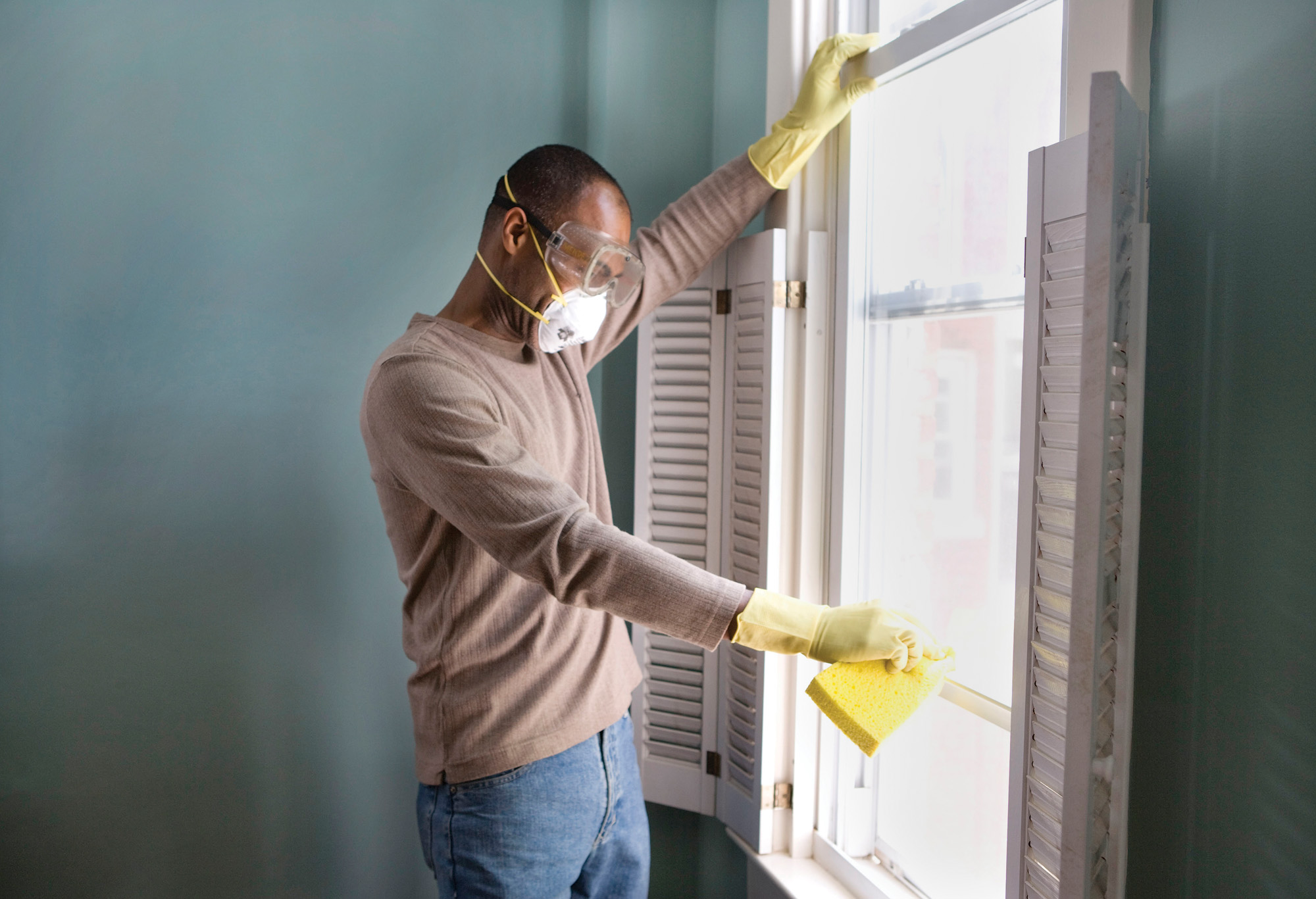 Because mold spores can aversely affect your health, wear gloves, goggles, and a mask when cleaning affected areas.