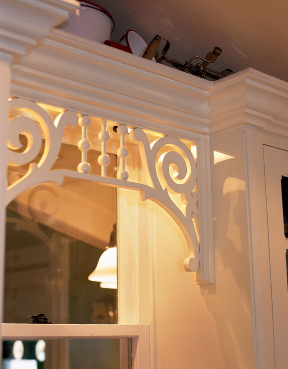 Closeup of the fretwork spandrel used over the sink in this Victorian Revival kitchen.