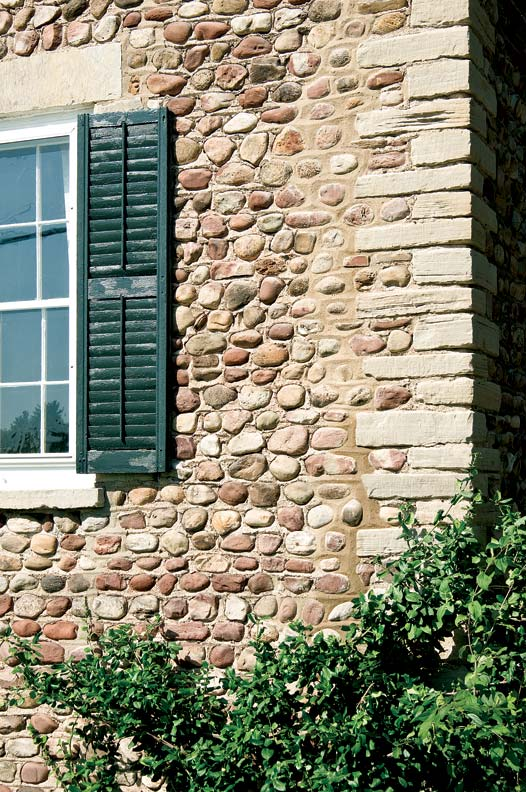 The cracks are gone; once the mortar cures completely, the new repairs will be indistinguishable from the original wall.