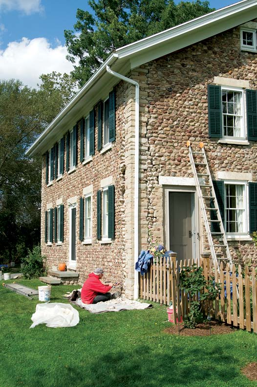 Improperly keyed quoins and years of inappropriate repairs had caused major cracking (visible above) on the corners of this cobblestone house in upstate New York. Stonemason Marty Naber restored the walls by removing old mortar and caulk and replacing it with new lime-based mortar.