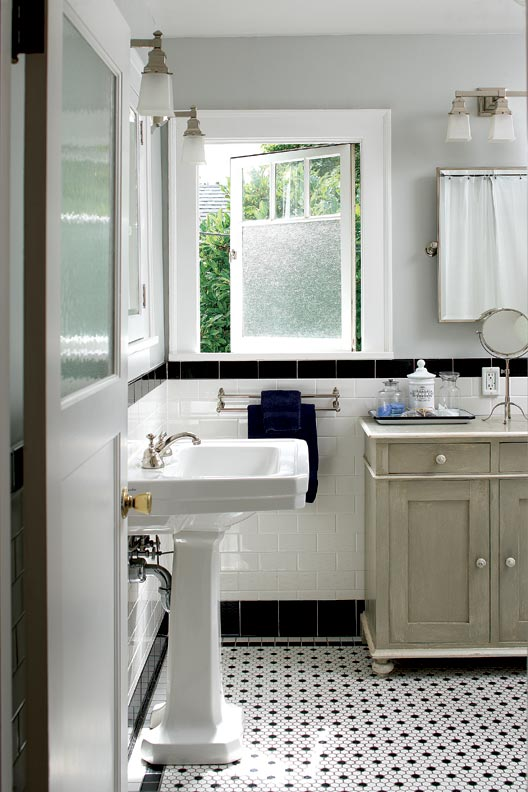 It may look utterly original, but the upstairs bath was a do-over. This version is period-perfect with black and white tiles and nickel fittings. The restored window with frosted glass was original to the room.