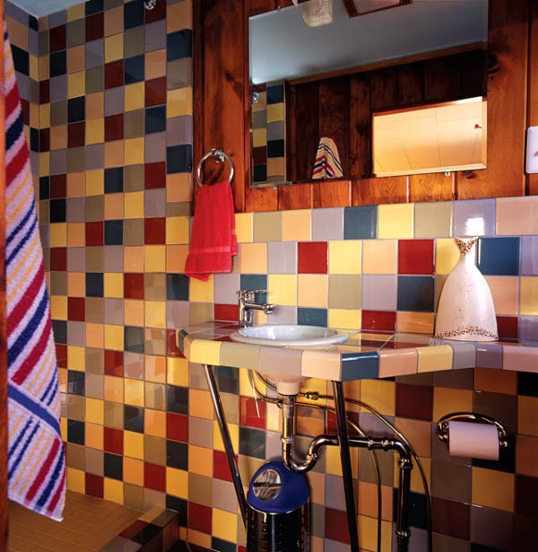 """Colorful tiles were handmade by the artisan duo Phillip Maberry and Scott Walker (whose own house was the location for the B-52s' """"Love Shack"""" video)."""