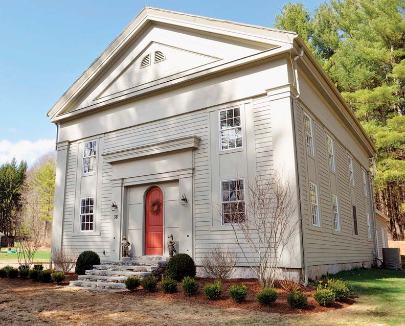 before: The temple-style Greek Revival building had been sheathed in vinyl and was long abandoned. after: New windows were set in panels to mimic original proportions. Stacked stone steps topped with granite slabs replaced a concrete pad.