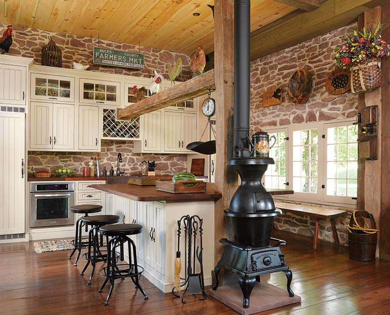 In the kitchen, simple white-painted cabinets were installed around the barn's posts and beams.
