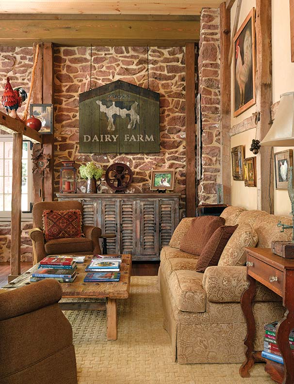 Opposite the big window at center, the living room pays homage to the barn's history with chicken and cow motifs.