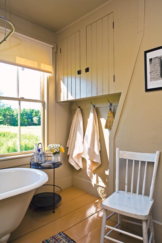 Country bathroom with beadboard cupboard