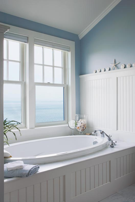Seaside bathroom with beadboard tub enclosure