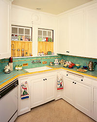 A less common countertop material, tile allowed for great expression and color combinations, such as the decor in this kitchen circa 1940, and was appreciated for its practicality because damaged tiles could be replaced individually.Photo Courtesy of Linda Svendsen