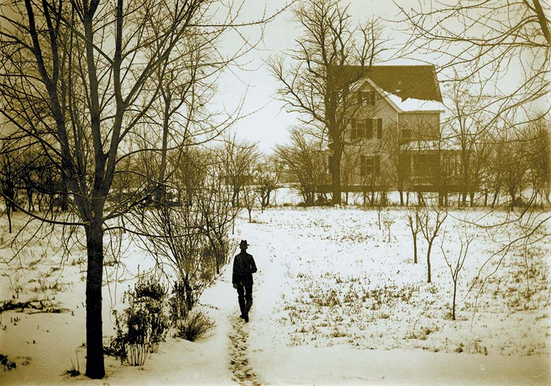 In 1901, Lemma's father, John, walks toward the Crabtree House from his father's adjacent home.