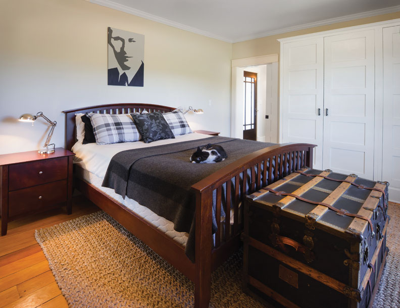 The painting in the master bedroom was inspired by a 1940s photograph found inside a wall.