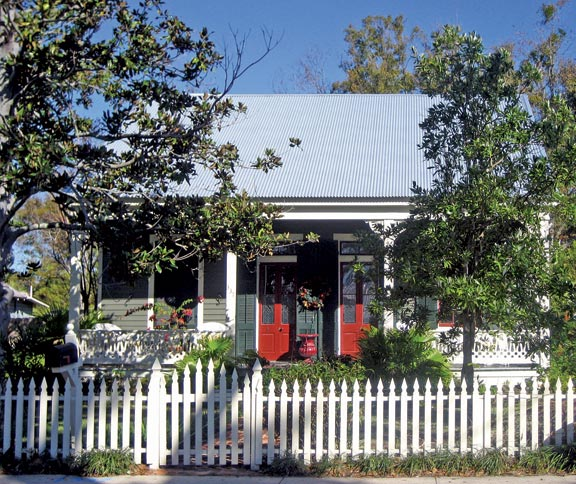 This restored Creole cottage, with its paired front doors, sits in Bay St. Louis, Mississippi, an early French settlement on the Gulf of Mexico.