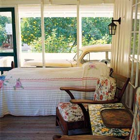 Marjorie Kinnan Rawlings' old car is parked right next to her sleeping porch in Cross Creek.