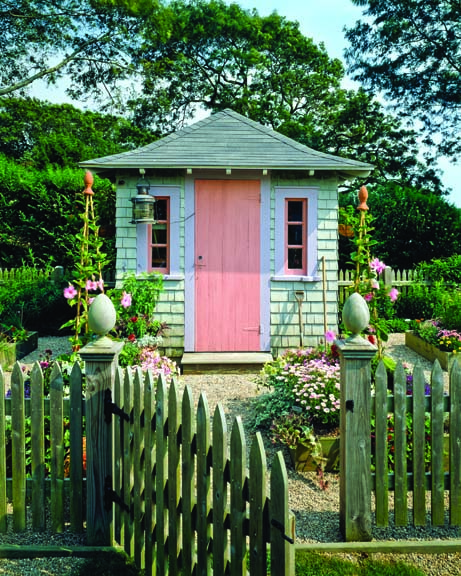 Shingled garden stylish shed with pink door