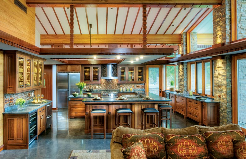 Michael Rust designed the kitchen, which offers warm, inviting wood tones and earthy tile touches.