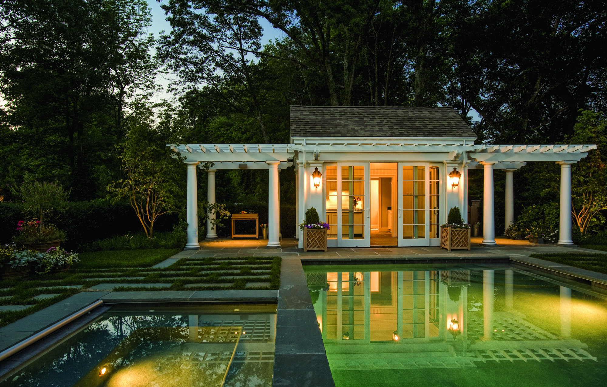 The pool house has perfect classical proportions and offers symmetry to the garden.
