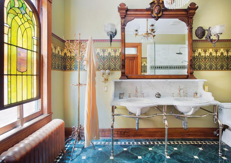 Bradbury & Bradbury's Iris Frieze paper creates the perfect backdrop for the master bathroom.