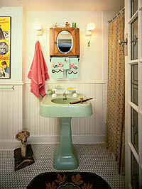 Lights flanking a mirror cut down on harsh shadows and offered optimum illumination for grooming. The shades here-called turtles because of their resemblance to the critter-could also be mounted facing the wall, and often sat on brackets made of porcelain that featured convenient, built-in electrical outlets.  Photo Courtesy of Linda Svendsen