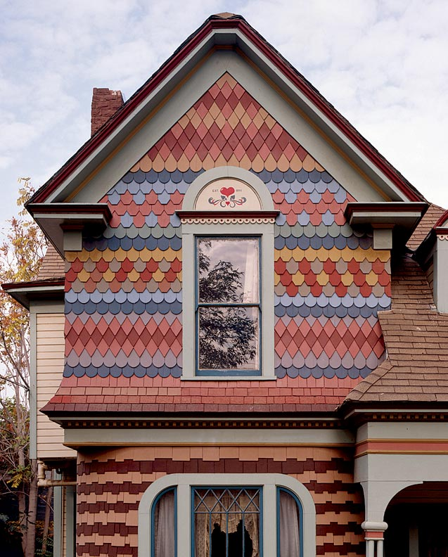 Polychrome painting playfully draws attention to the patterns created by fancy-butt shingles. Photo: Douglas Keister