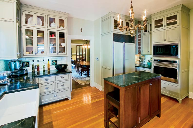 Designed with Bill, the chef of the family, in mind, the new kitchen is a blend of period elements and modern amenities. Bill designed the small island to provide extra prep space.