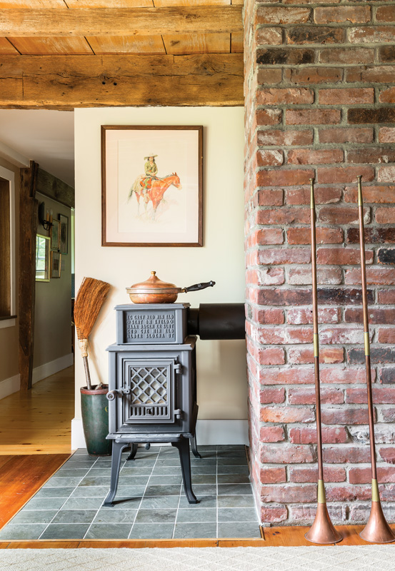 Designer Sally Wilson found a location for a wood stove.