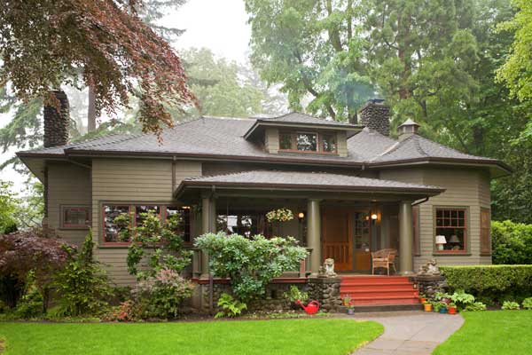 Despite river-rock accents, flared eaves, and even an octagonal tower room, the bungalow has a certain formality.