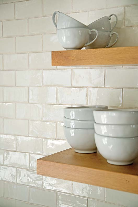 Details were kept simple—white tile and open shelving.