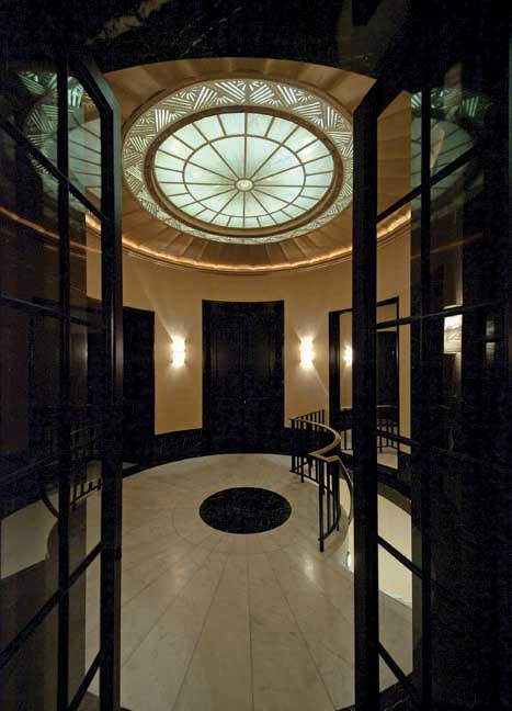 Dining room doors open onto the home's dramatic rotunda.