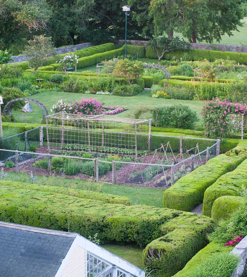 "Divided into ""rooms,"" the garden boasts flowerbeds in the center, with vegetables and cutting flowers on either side."