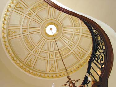 """Plaster? The dome ceiling is embellished with J.P. Weaver's pliable """"Petitsin"""" compo ornaments. The small medallion is Focal Point's egg-and-dart pattern #833 in polyurethane."""
