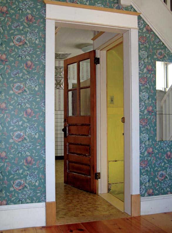 The author moved this original four-light exterior door from the back wall of his kitchen to the top of his cellar stairs.