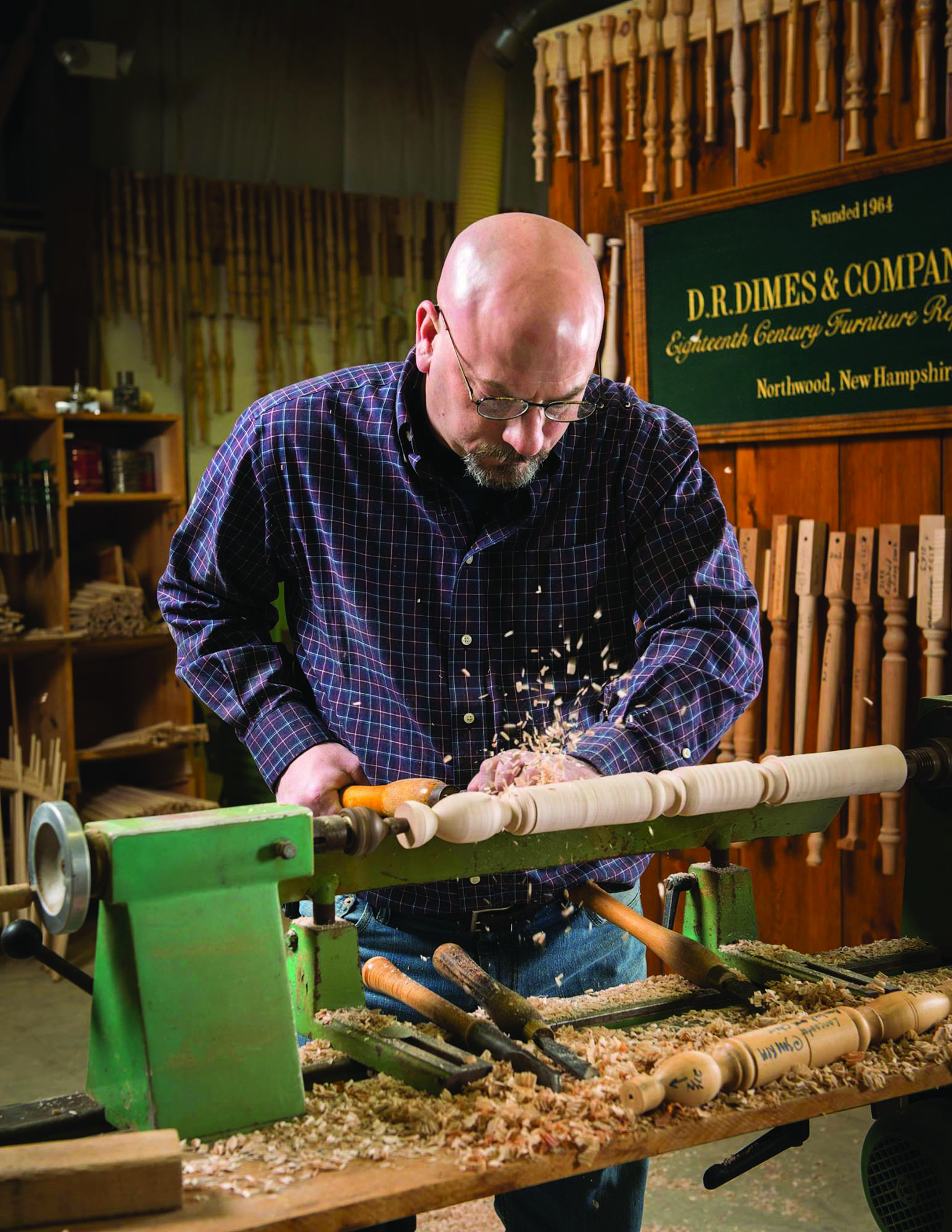 Like his father before him, Doug Dimes turns table legs by hand on a lathe.